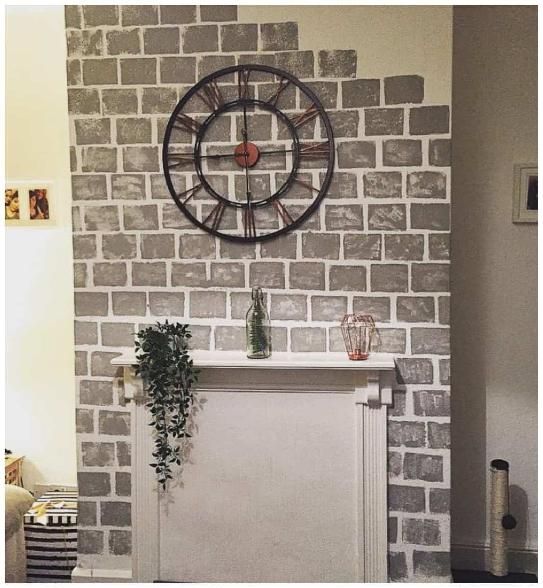 This is How to Paint a Faux Brick Fireplace! What a fun DIY Project Idea and simple too! This was done with a sponge and paint! The whole project takes 40 mins