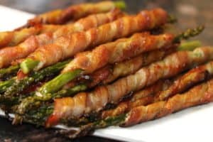 Keto Bacon Wrapped Asparagus made with a secret sauce!