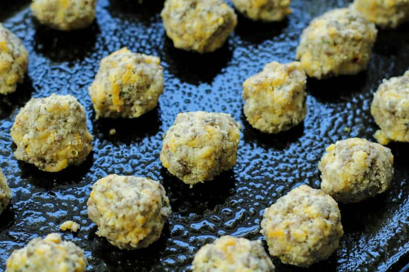 Keto Sausage Balls unbaked on a baking tray