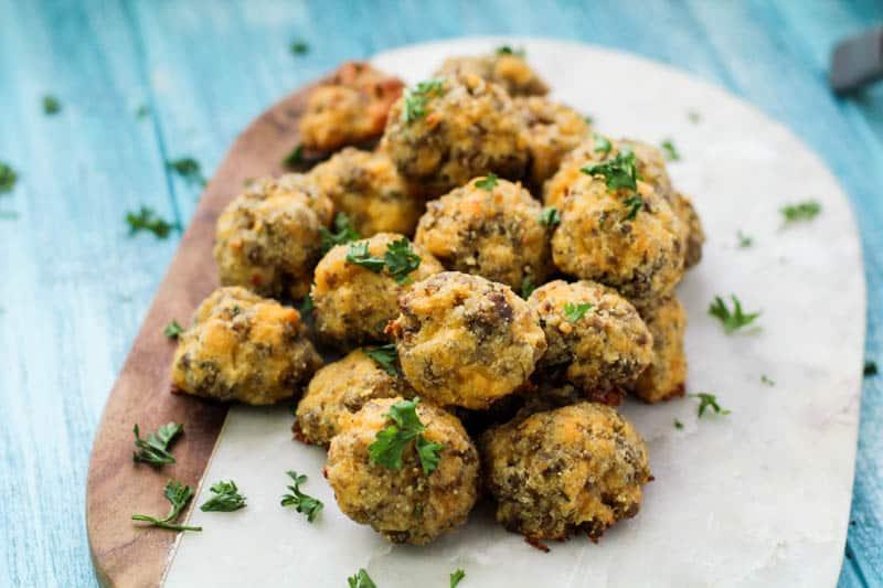 Keto Sausage Balls on a marble tray with parsley garnish