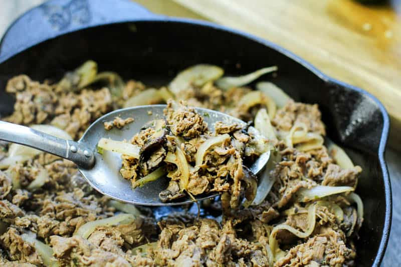 cheese steak mixture in a cast iron pan