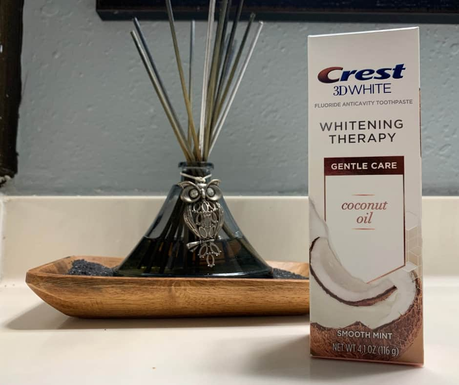 We've all seen the charcoal and coconut oil brushing happening, but have you seen how messy it is? Learn how to get white teeth with the new Crest 3D White Whitening Therapy with Charcoal and Coconut Oil. #Sponsored #CrestSmiles #VanillaMintCoconutOil