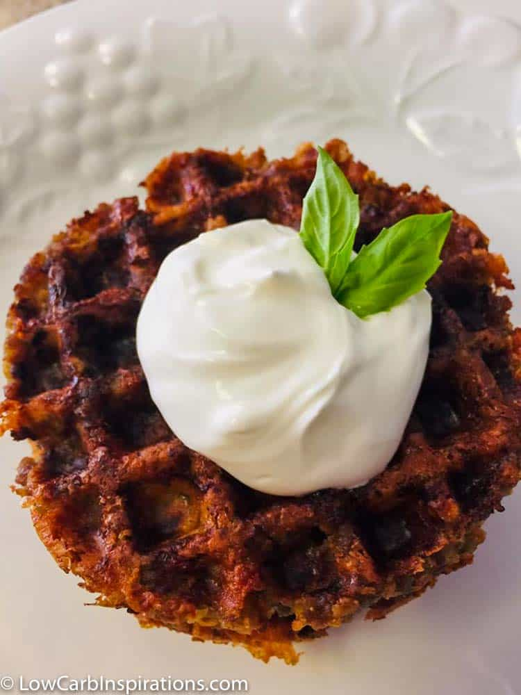 Keto Sausage Ball Chaffle Recipe Topped with sour cream!